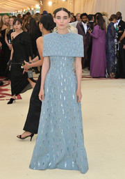 Rooney Mara looked simply regal in a capelet-detailed powder-blue gown by Givenchy Couture at the 2018 Met Gala.