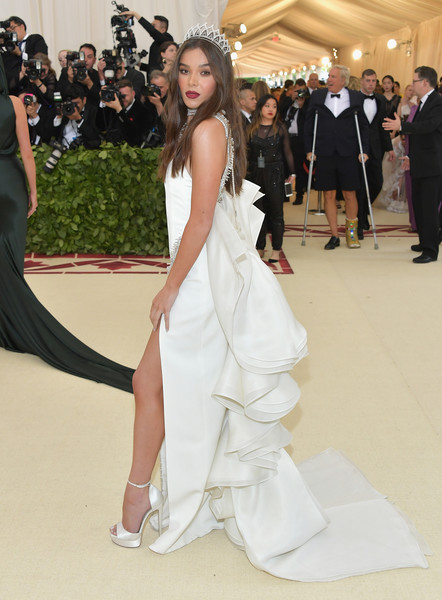 Hailee Steinfeld complemented her dress with white ankle-strap platforms by Jimmy Choo.