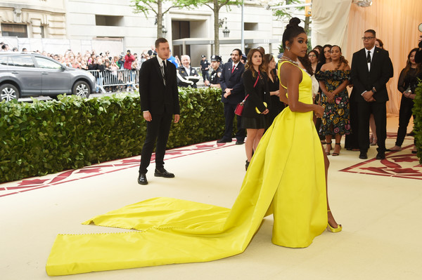 More Pics of Gabrielle Union Evening Dress (1 of 9) - Dresses & Skirts Lookbook - StyleBistro [yellow,red carpet,dress,fashion,carpet,event,flooring,haute couture,gown,car,heavenly bodies: fashion the catholic imagination costume institute gala - arrivals,new york city,metropolitan museum of art,gabrielle union]