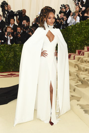 Jourdan Dunn looked dramatic in a white cape-sleeve gown by Diane von Furstenberg at the 2018 Met Gala.