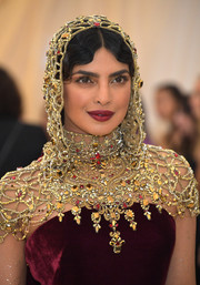 Priyanka Chopra showed off a gorgeous Swarovski crystal-embellished hood by Ralph Lauren at the 2018 Met Gala.