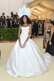 Winnie Harlow attended the 2018 Met Gala looking like a bride in a strapless white corset gown by Tommy Hilfiger.