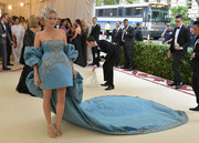 Diane Kruger made an unforgettable entrance in an embroidered aqua-blue Prabal Gurung dress with puffed sleeves and a long train at the 2018 Met Gala.