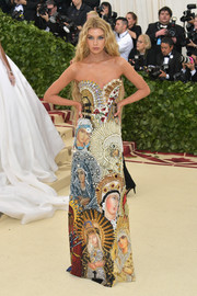 Stella Maxwell was a graphic explosion in a strapless, Virgin Mary-themed gown by Moschino at the 2018 Met Gala.