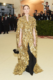 Evan Rachel Wood showed off a feather-motif sequined coat by Altuzarra at the 2018 Met Gala.