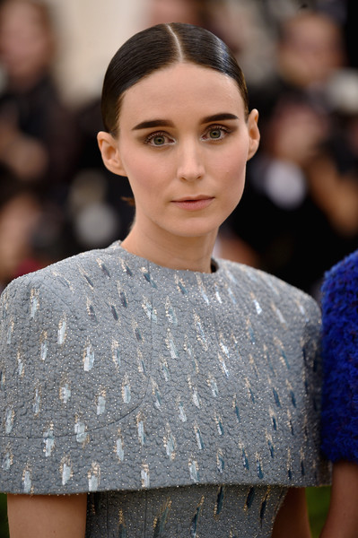 Rooney Mara sported a slick center-parted chignon at the 2018 Met Gala.