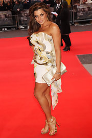 Louise's tanned gams look fabulous in her gold strappy evening sandals.