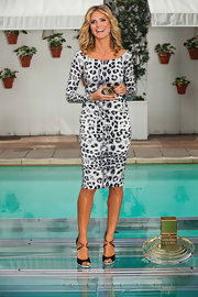 Heidi accessorized her animal print frock with ultra fierce shoes. Her black suede sandals with a pink satin criss-cross band and a python-print platform were the perfect complements to her trendy ensemble.