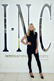 Heidi Klum visited the INC International Concepts shop wearing a black cap-sleeve turtleneck from the brand.