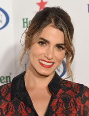 Nikki Reed rocked a messy-gorgeous updo at the Heineken US Open kick-off party.