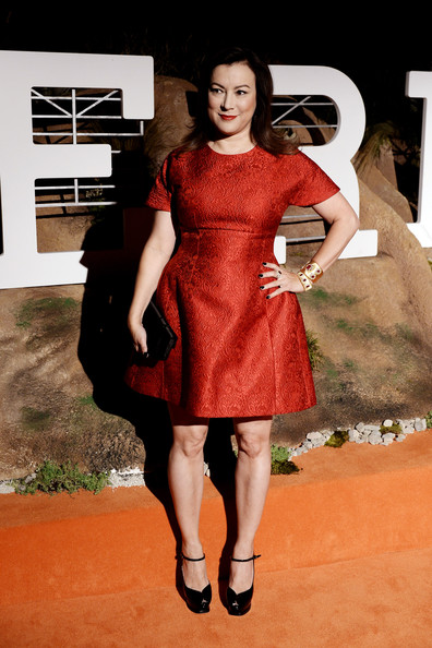 Jennifer Tilly was retro-glam on the red carpet in a textured red cocktail dress during the Hermes Beverly Hills boutique after-party.