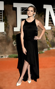 Teresa Palmer went for simple elegance in a sleeveless black maxi dress when she attended the Hermes Beverly Hills boutique after-party.