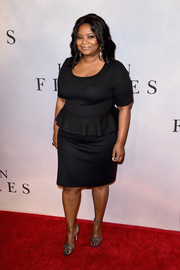 Octavia Spencer styled her dress with silver glitter sandals by Jimmy Choo.