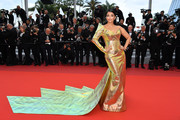 Aishwarya Rai was a stunner in a gold one-shoulder gown with a flowing train at the 2019 Cannes Film Festival screening of 'A Hidden Life.'