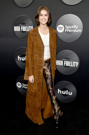 Kaia Gerber was hippie-glam at the New York premiere of 'High Fidelity' wearing print pants under a floor-grazing suede coat.
