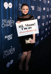 Joey King attended Hilarity for Charity's variety show carrying in a quirky mosaic clutch.