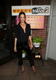 Alessandra Ambrosio went for an edgy finish with a pair of black vinyl capris by RtA x Anna Dello Russo.