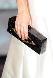 Evangeline Lilly carried a sparkling black and gold clutch to the world premiere of 'The Hobbit: Battle of the Five Armies.'
