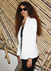 Afef Jnifen attended the 'Hogan And Big Bambu' cocktail party in an elegant white blazer.