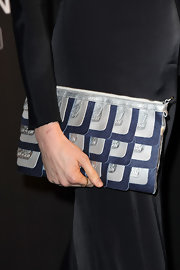 Elettra Wiedemann attended the Hogan by Karl Lagerfeld cocktail party carrying a modern metallic silver and blue clutch.