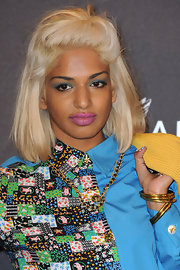 M.I.A paired her printed look with matte pink lipstick. The intrepid style star opted for more color with a swipe of blue shadow.