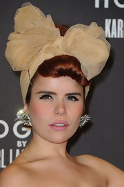 Paloma Faith paired her soft look with matte pink lipstick and heavy top liner.