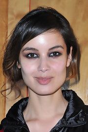 Berenice Marlohe attended the Hogan by Karl Lagerfeld fall 2012 presentation wearing lots of smudged back liner to create a smoky-eyed effect.