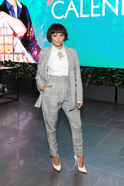 Kat Graham hit the special screening of 'The Holiday Calendar' wearing a gray plaid pantsuit by Etro.