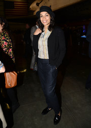 Rosario Dawson chose a pair of navy slacks to finish off her look.