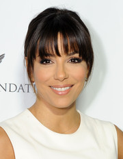 Eva Longoria looked youthful at the Q&A with Ann Curry event wearing a casual ponytail and wispy bangs.