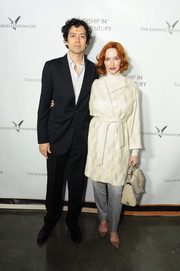 Christina Hendricks topped off her ensemble with a white and gray single-strap tote by Tory Burch.