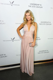 Joanna Krupa looked totally red carpet-ready in a pink gown with a deep plunge when she attended the Q&A with Ann Curry event.