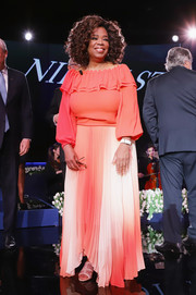 Oprah Winfrey pulled her look together with a pair of nude gladiator heels.