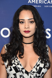 Devika Bhise wore her hair in a long cascade of curls during the New York screening of 'The Hollars.'