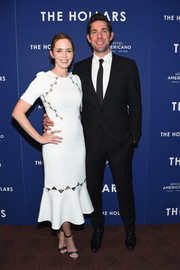 Emily Blunt styled her dress with silver ankle-strap sandals by Tory Burch.