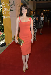 Check out Carla's enviable hourglass figure in this vibrant orange dress at the Hollywood Foreign Press Association's luncheon.