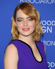 Emma Stone styled her hair with piecey waves for the HFPA Grants Banquet.