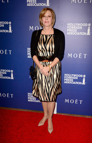 JoBeth Williams styled her dress with a black cardigan.