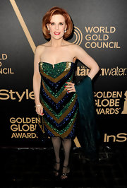 Kat was all about the glitz in this strapless chevron sequined dress at the Golden Globe award season celebration.