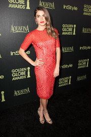 Nikki Reed donned a patterned red sheer-overlay dress by Sachin & Babi for the Golden Globe Award season celebration.