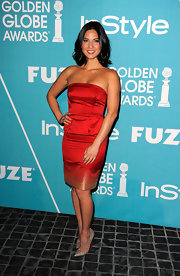 Olivia Munn shined in red at the 'InStyle' soiree. She accessorized the look with metallic stilettos.