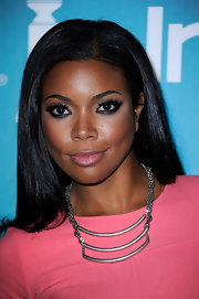 Gabrielle Union wore sultry shades of gray and black shadow to create her smoky-eyed makeup look at A Night of Firsts.
