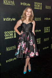 Sasha Pieterse went for '50s charm at the Golden Globe Award season celebration in a fit-and-flare dress with a feminine floral print on the skirt.