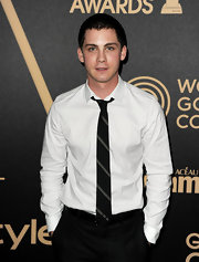 Logan Lerman complemented his white shirt with a striped tie at HFPA and InStyle's celebration of the 2013 Golden Globe Awards Season.
