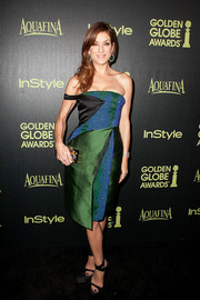 For her arm candy, Kate Walsh chose a metallic patchwork box clutch by Emm Kuo.