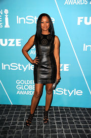 Garcelle Beauvais topped off her studded frock with black strappy sandals.