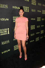 Tracee Ellis Ross showed plenty of leg in a pink mini dress during the Golden Globe Award season celebration.