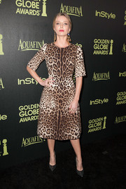 Annabelle Wallis went the wild route with this Dolce & Gabbana leopard-print dress at the Golden Globe Award season celebration.