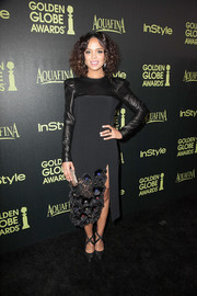 Tessa Thompson completed her look with black ankle-tie pumps by Oscar Tiye.