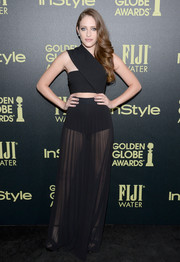 Carly Chaikin wore a black cut-out dress with a sheer pleated skirt for a sexy and chic look.